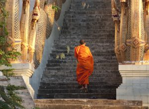 Monk climbing stairs in Chiang Mai